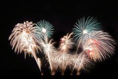 Festive colorful fireworks on night sky background. Celebratory holiday.  royalty free stock photos