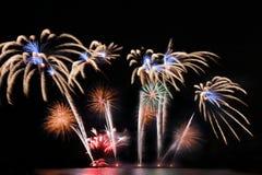 Festive colorful fireworks on night sky background. Celebratory holiday.  stock photo