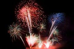 Festive colorful fireworks on night sky background. Celebratory holiday.  stock image