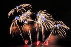 Festive colorful fireworks on night sky background. Celebratory holiday.  stock images