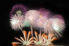 Festive colorful fireworks on night sky background. Celebratory holiday.  royalty free stock photography