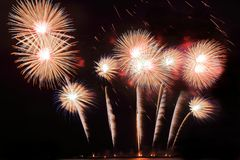 Festive colorful fireworks on night sky background. Celebratory holiday.  stock photos