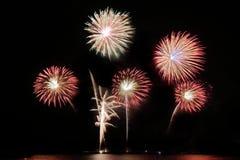 Festive colorful fireworks on night sky background. Celebratory holiday.  stock photography