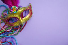 Festive, colorful group of mardi gras or carnivale mask on purple background. stock photos