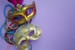 Festive, colorful group of mardi gras or carnivale mask on purple background. Festive, colorful group of mardi gras or carnivale mask on a purple background stock photos