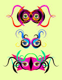Festive colorful masks. Three festive masks with eyes looking out Stock Photo