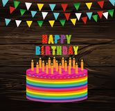Festive colorful rainbow and a big cake with candles. Happy Birt. Hday. Greeting card or invitation for a holiday. Vector on wooden background Royalty Free Stock Photos