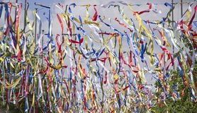Festive colorful ribbons on a clear sky background stock photos