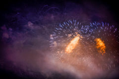 Festive colour firework background. At a dark night Royalty Free Stock Image