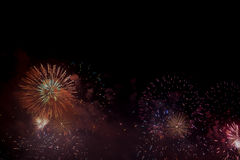 Festive colour firework background. At a dark night Royalty Free Stock Photos