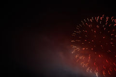 Festive colour firework background. At a dark night Royalty Free Stock Images