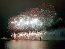 Festive colourful fireworks, against dark night sky