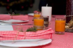 Festive composition with candles and plates. Table decoration. A beautiful table setting, red table cloth, tablecloth in the box. Royalty Free Stock Photography