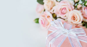 Festive composition with flowers and gift box Royalty Free Stock Photography