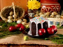Festive composition made of Easter cake kulich and red coloured quail eggs. Festive composition made of Easter cake kulich, red coloured quail eggs and spring Royalty Free Stock Photo