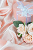 Festive composition with roses and gift box Royalty Free Stock Photography