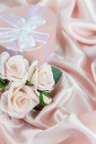 Festive composition with roses and gift box Stock Images