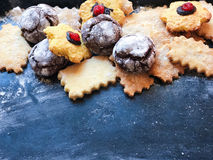 Festive cookies on a black kitchen board with powdered sugar Stock Photos