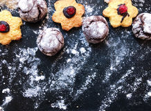 Festive cookies on a black kitchen board with powdered sugar Stock Photo