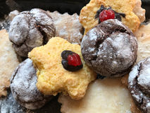 Festive cookies on a black kitchen board with powdered sugar Royalty Free Stock Image