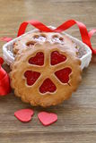 Festive cookies decorated with Jelly hearts Stock Photos