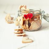Festive Cookies in Jar Decorated with Hearts Stock Images
