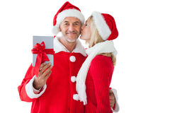 Festive couple embracing and holding gift Stock Photo