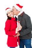 Festive couple exchanging christmas gift Stock Photo