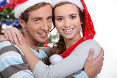 Festive couple hugging Royalty Free Stock Images