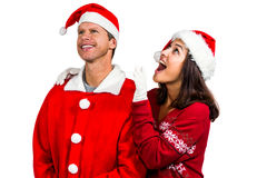 Festive couple looking up together Stock Image