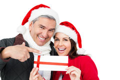 Festive couple pointing christmas gift Royalty Free Stock Photography
