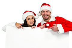 Festive couple showing a poster Royalty Free Stock Photos