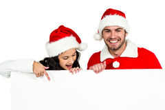 Festive couple showing a poster Royalty Free Stock Photo