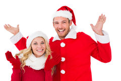 Festive couple smiling with arms raised Royalty Free Stock Photos