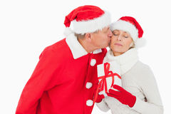 Festive couple smiling and holding gift Royalty Free Stock Photo