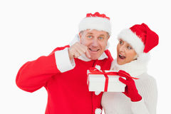 Festive couple smiling and holding gift Royalty Free Stock Photos