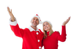 Festive couple standing with arms raised Stock Photo