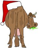 Festive Cow. This illustration depicts the rear view of a cow with a giant Santa hat on its back Royalty Free Stock Images