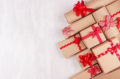 Free Festive Craft Paper Gifts With Red Bows Closeup On Soft White Wood Board, Top View, Border. Stock Images - 129507254