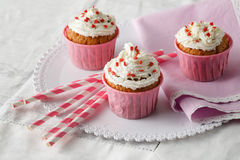 Festive cupcake with cream and heart decorations Stock Photography