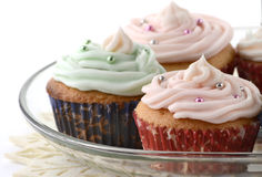 Festive cupcakes. On glass tiered stand on white background Royalty Free Stock Photo