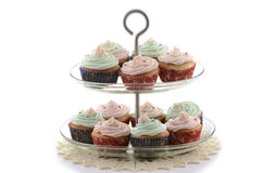 Festive cupcakes. On glass tiered stand on white background Royalty Free Stock Images