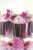 festive cupcakes in a shiny package with decoration in the form of cream and pink hearts royalty free stock images