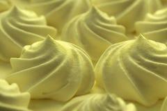 Festive curls for cake meringue cream yellow color stock image