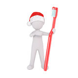 Festive 3d man in a Santa hat with a toothbrush. Festive little 3d man in a Santa hat standing with a large red toothbrush in his hand conceptual of dental Royalty Free Stock Image