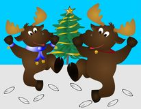 Festive Dancing Moose. Two dancing festive moose, with bells and ribbons on in the snow.  A Xmas tree in background Stock Image