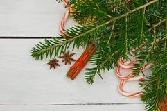 Festive decor: sweets, dried fruits, cinnamon, anise, Christmas stock image