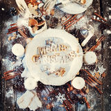 Festive Decor on Wooden Table. Baked Letters Merry Christmas Stock Image