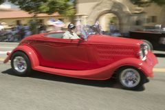 Festive decorated antique automobile makes its way down main street during a Fourth of July parade in Ojai, CA Stock Image