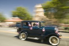 Festive decorated antique automobile makes its way down main street during a Fourth of July parade in Ojai, CA Stock Photos